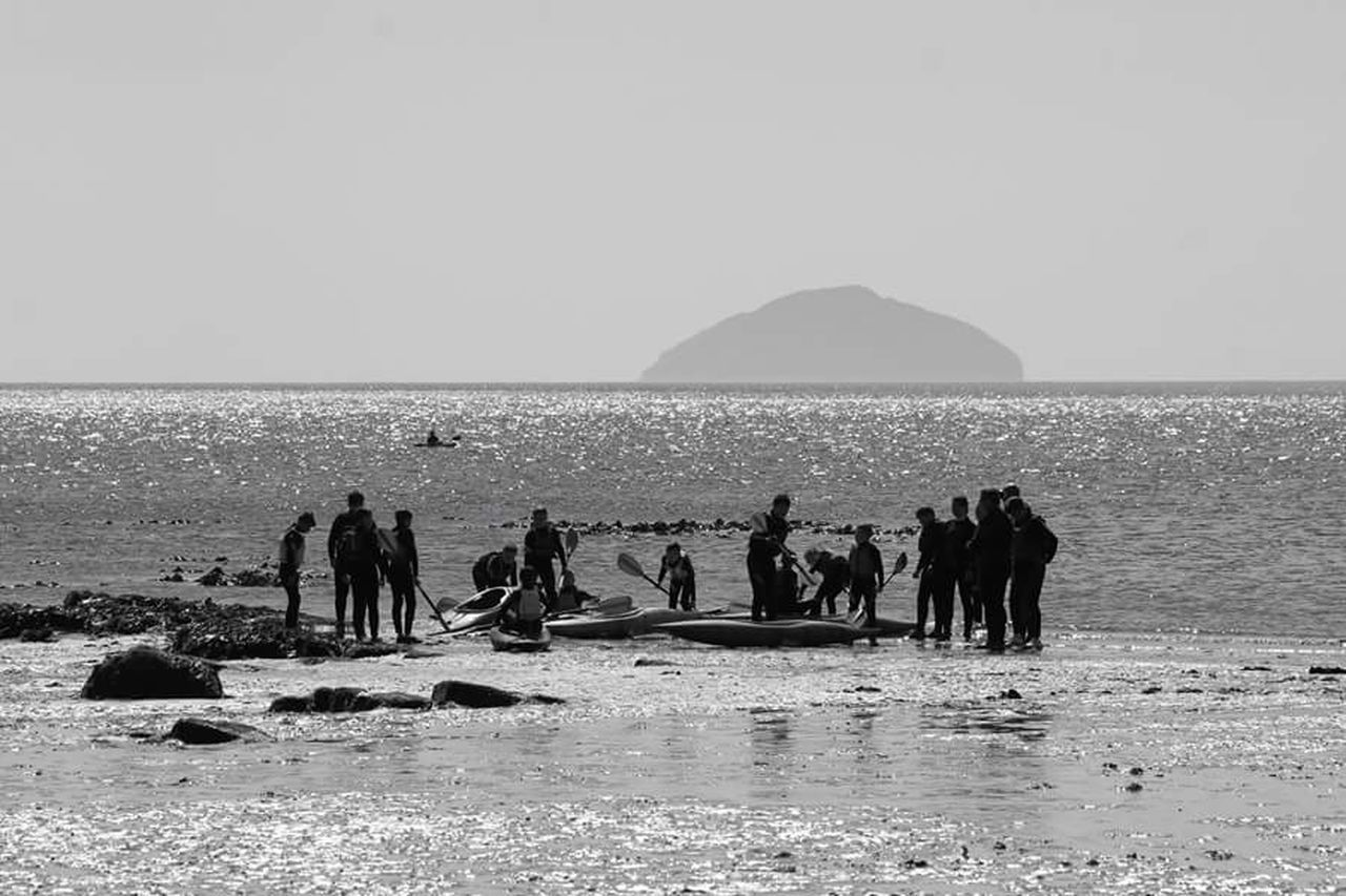 People Of The Oceans Sand People Photography People Watching Black And White Sea And Sky Sea Black & White Ayrshire People Canoes Fun Sport Group Of People Adventure Club