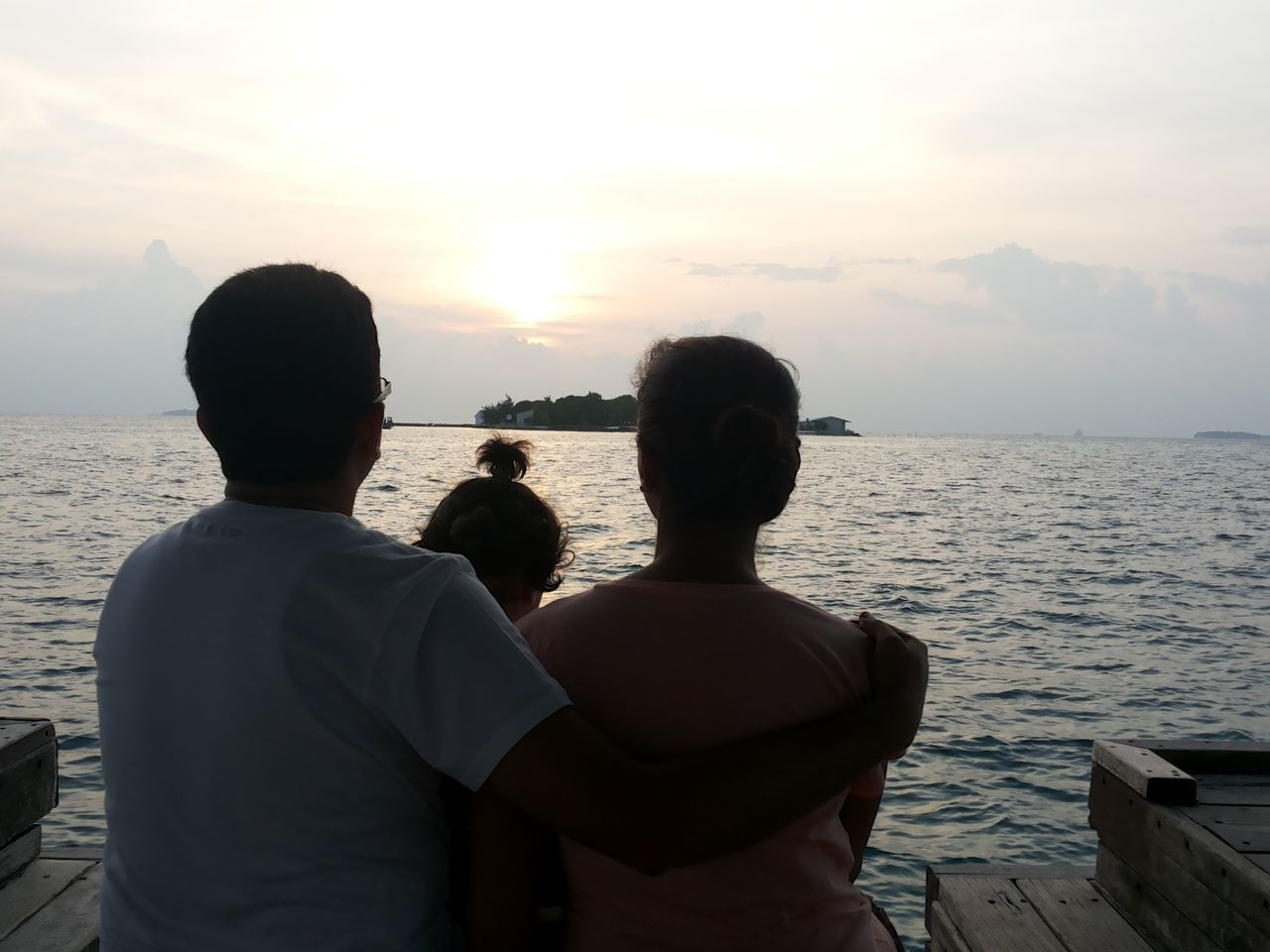 sea, sunset, water, two people, togetherness, rear view, love, men, scenics, sky, nature, leisure activity, idyllic, beauty in nature, bonding, real people, standing, tranquility, vacations, horizon over water, outdoors, friendship, day, adult, people