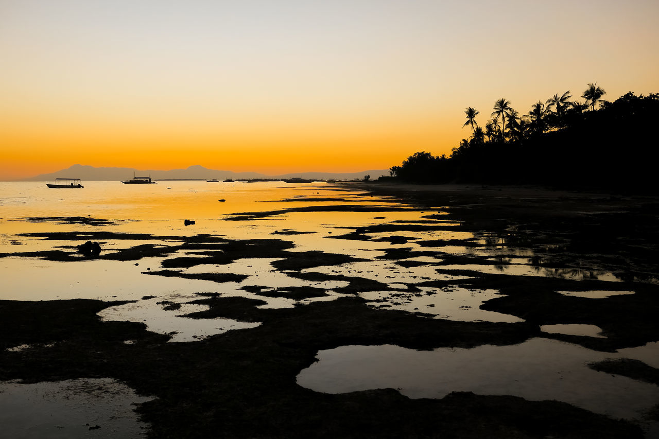 Reflective tide pools during an unforgettable island sunset Alona Alona Beach Beach Sunset Bisaya Bohol Coconut Tree Silhouette Exotic Fiery Sunset Island Living Island Sunset Island Time Island View  It's More Fun In The Philippines Low Tide Orange Sunset Paradise On Earth Philippines Photos Silhouette Simple Life Simple Living The Good Life Tide Pool Tidepools Visayas Wow Philippines