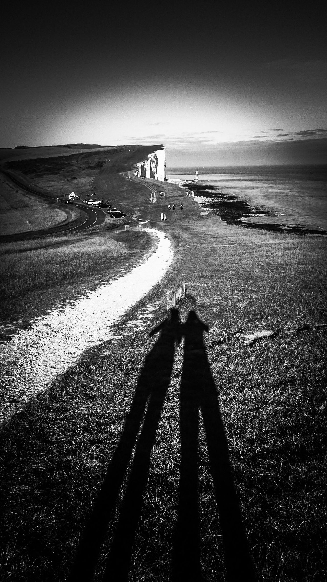 Sunlight Silhouette Sky Togetherness People Two People Outdoors Nature Grass Sunset Sunbeam Blackandwhite Photography Beach Coastline Landscape Sea Lighthouse Chalk Cliffs Beachy Head Day East Sussex The Way Forward