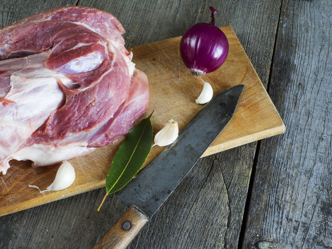 raw pork shank on cutting board on old weathered wooden background Background Close-up Cutting Day Food Food And Drink Freshness Healthy Eating High Angle View Horizontal Indoors  Knife Meat No People Old Pork Raw Ready-to-eat Shank Table Weathered Wooden