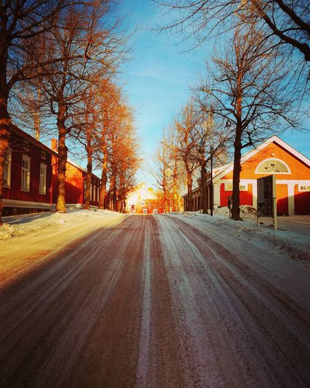 The Way Forward Architecture Built Structure Building Exterior Old Buildings Wintertime Cold Outside Picturesque No People Tree Sky Outdoors Road City Day Milieu Straight Ahead Wooden Houses Sunny Day Atmospheric Shades Of Red Red Buildings Neighborhood Map