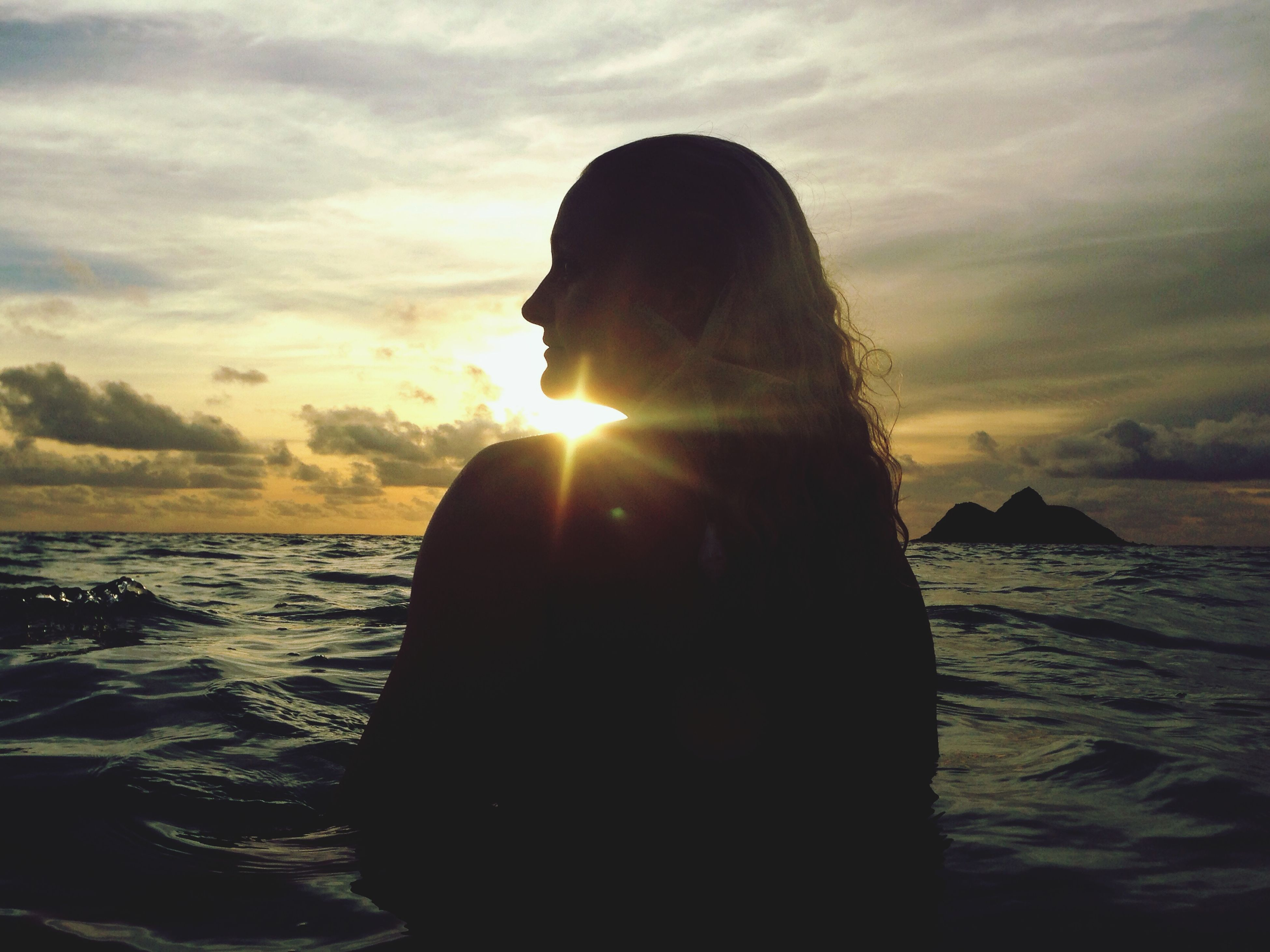 sunset, sky, sea, sun, water, beauty in nature, cloud - sky, scenics, tranquility, silhouette, tranquil scene, rock - object, nature, horizon over water, idyllic, sunbeam, one person, sunlight, cloud, rock formation