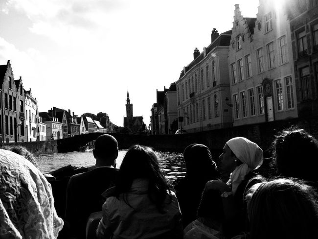 Paseo en barca // Boat trip Architecture Black & White Black And White Blackandwhite Brigde Building Exterior Built Structure City Day Large Group Of People Lifestyles On Boat Outdoors People Real People Rear View River Sky Togetherness Tranquility Travel Destinations