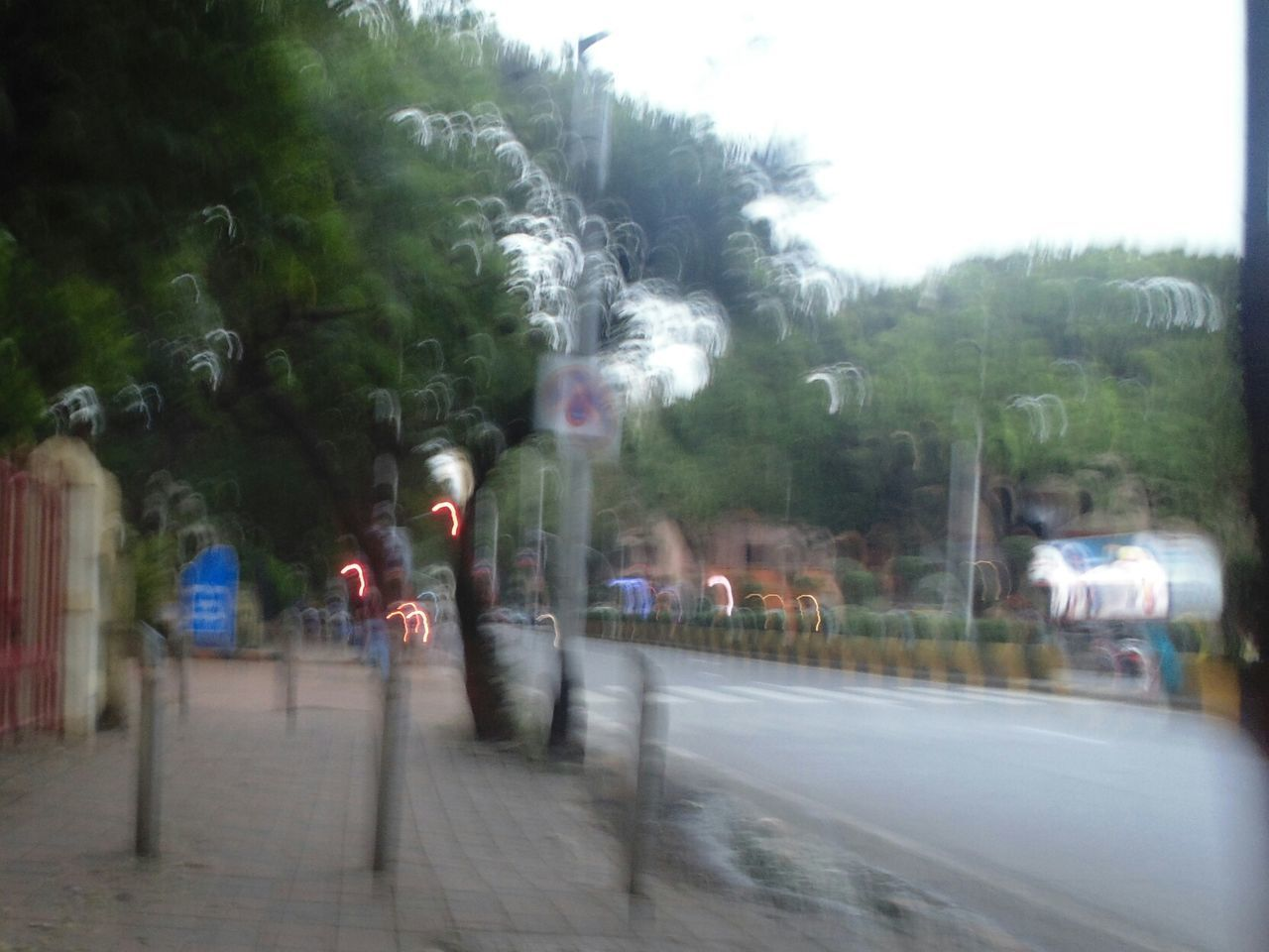 blurred motion, tree, road, transportation, day, the way forward, real people, outdoors, men, architecture, nature, sky, people