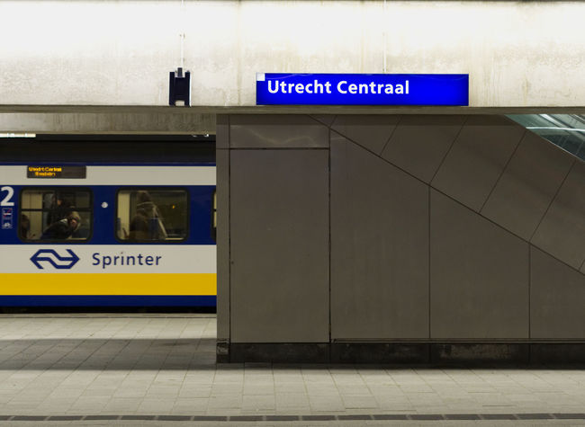 EyeEm Olympus Station Utrecht , Netherlands Blue Communication Day Indoors  No People Olympus Om-d E-m10 Public Transportation Railroad Station Railroad Station Platform Streetphotography Text Train Transportation Yellow