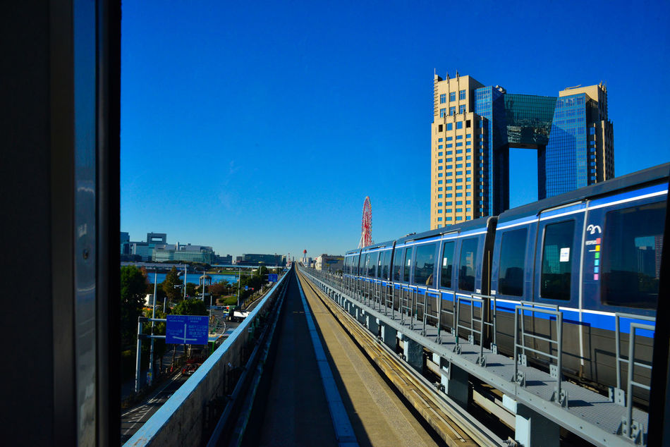 Architecture Blue Built Structure City City Life City Street Cityscape Day Diminishing Perspective Modern Odiba Public Transportation Railroad Track Sky The Way Forward Transportation Yurikamome Train Blue Wave Feel The Journey Ultimate Japan