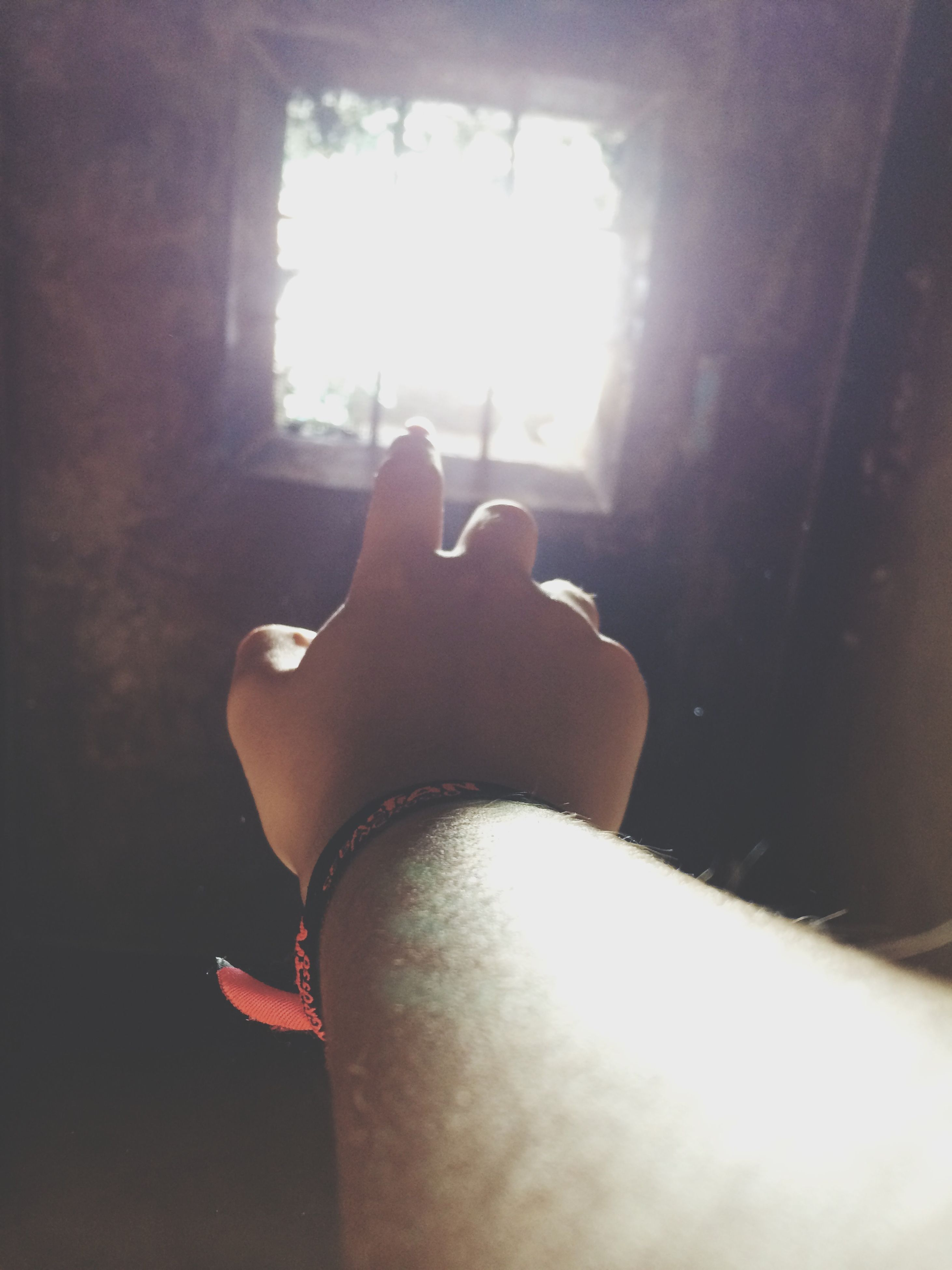 indoors, personal perspective, part of, home interior, person, sunlight, lifestyles, window, close-up, low section, domestic room, relaxation, cropped, unrecognizable person, human finger