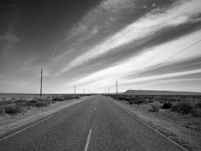 """""""Infinity"""" Vanishing point on a lonely rural highway in Central New Mexico. Roads New Mexico Photography New Mexico Clouds Vanishing Point Rural Road Rural Blackandwhite Photography Black And White Blackandwhite The Way Forward Diminishing Perspective Road Transportation Sky No People Day Landscape"""