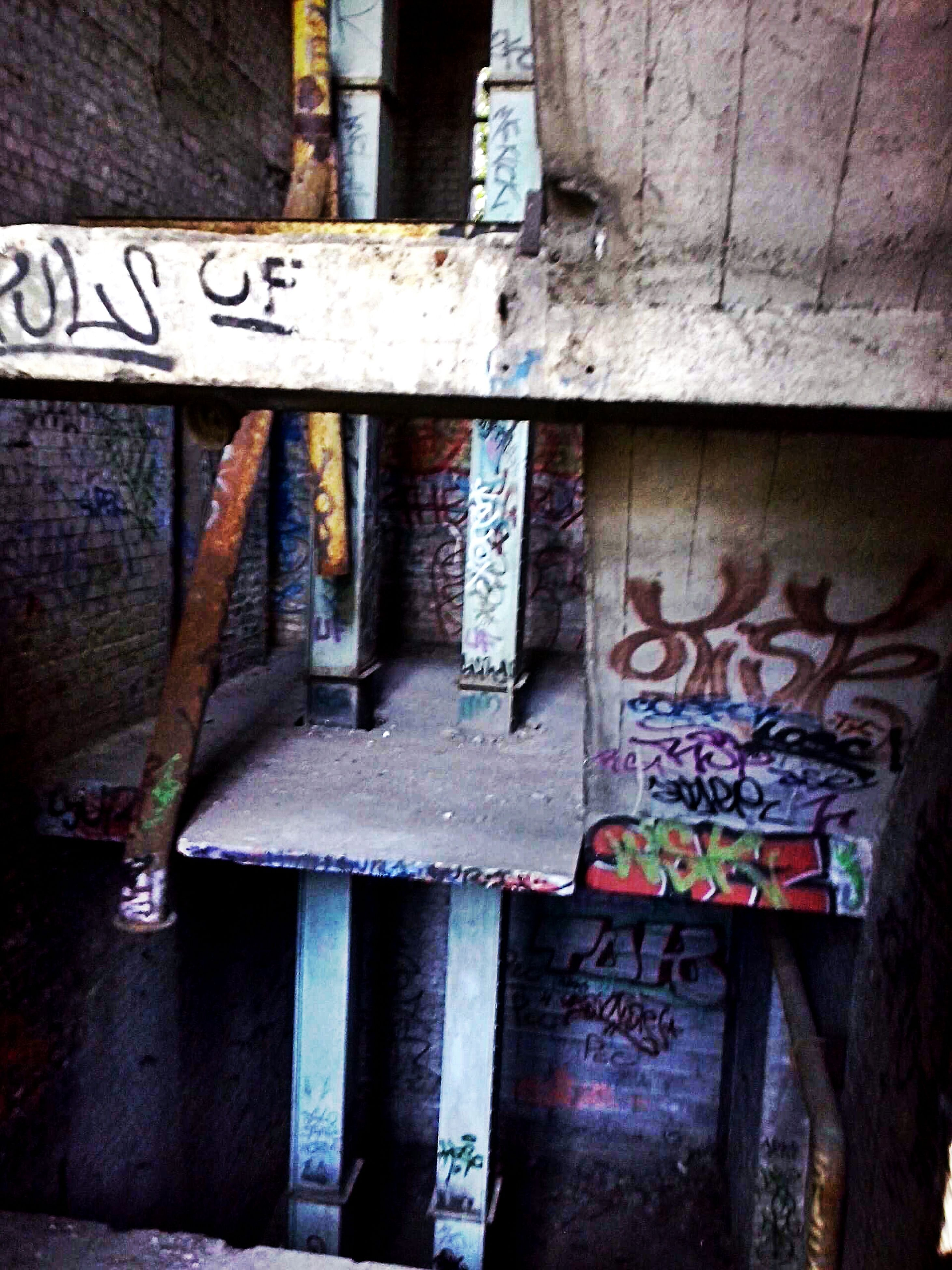 text, graffiti, architecture, old, built structure, wall - building feature, abandoned, obsolete, western script, indoors, damaged, wall, deterioration, run-down, weathered, communication, non-western script, building exterior, wood - material, no people