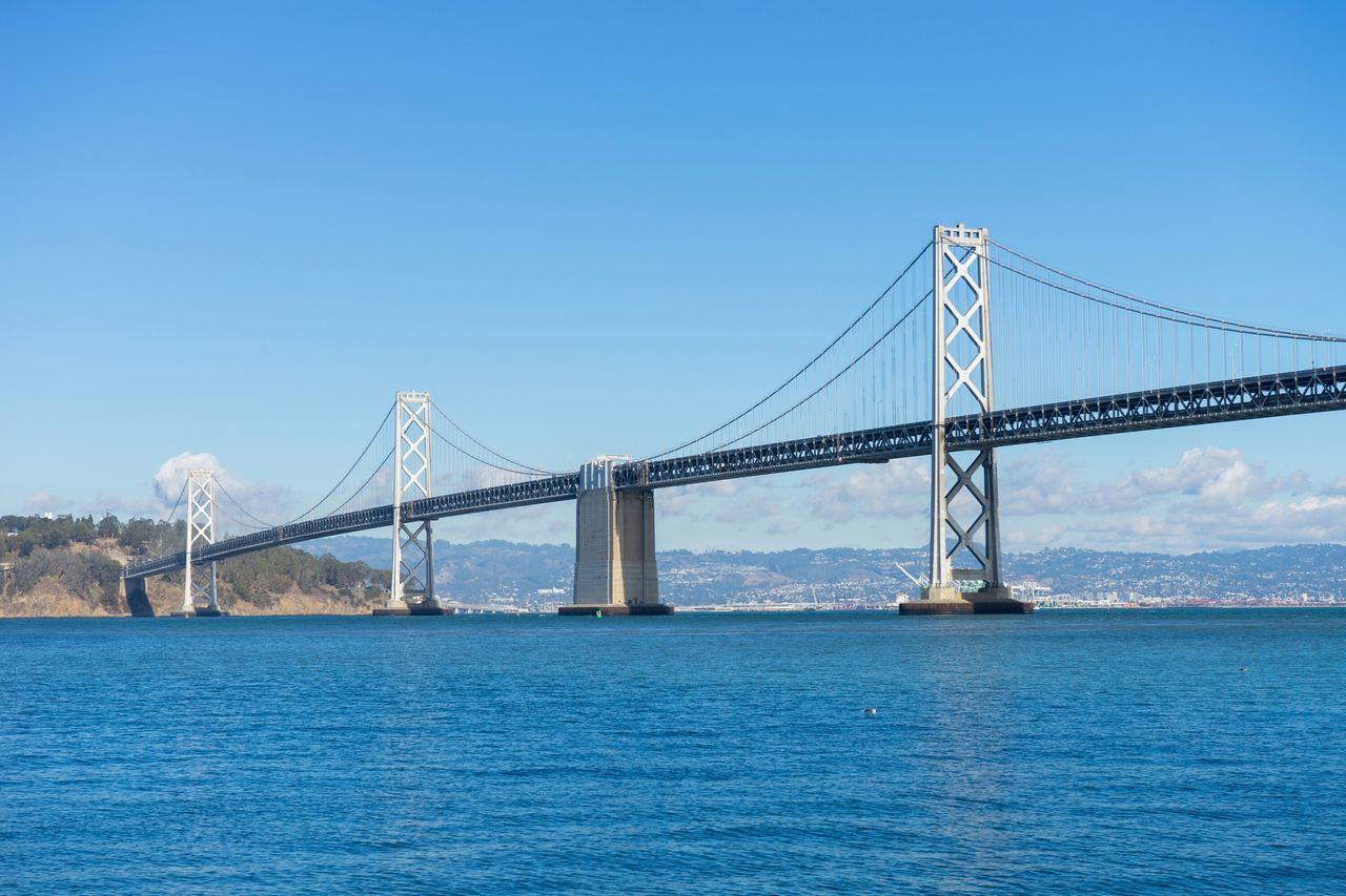Bay Bridge Over River Against Sky