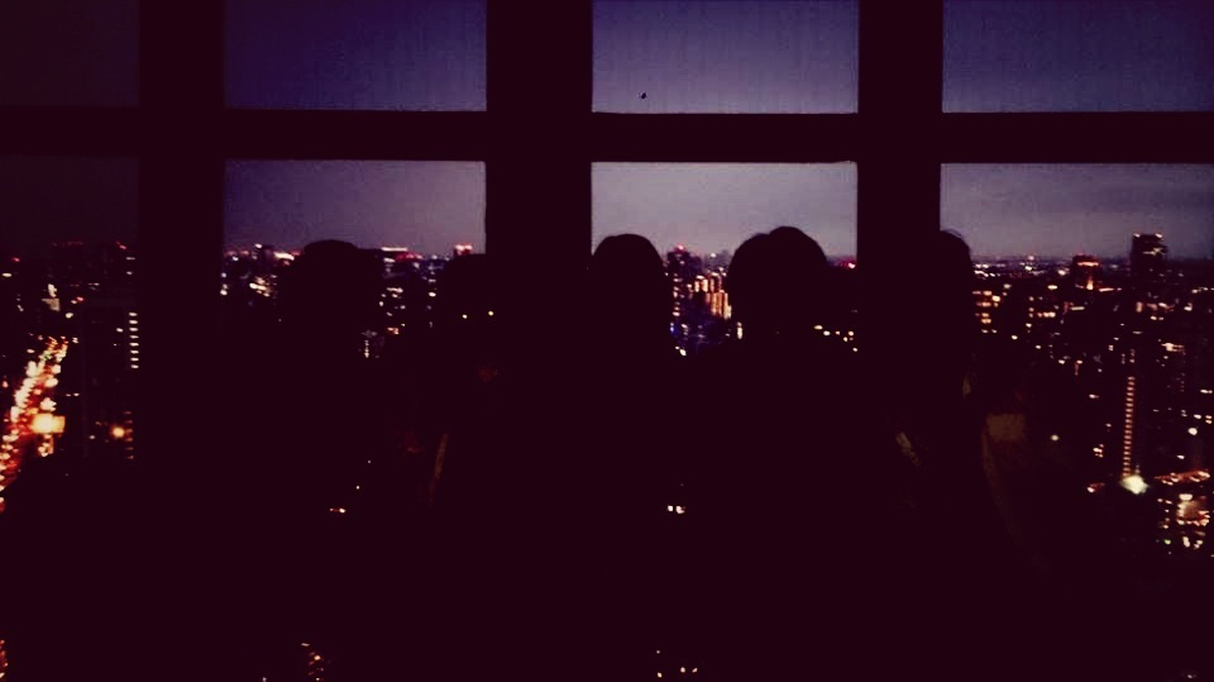 indoors, illuminated, silhouette, architecture, built structure, night, city, building exterior, dark, men, window, lifestyles, large group of people, city life, person, modern, glass - material, leisure activity, skyscraper