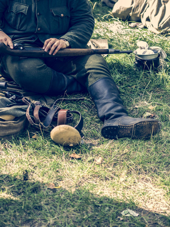Soldier of the Ukrainian Insurgent Army, World War II Army Casual Clothing Day Field Food Food And Drink Freshness Grass Grassy Gun Gununkaresi Insurgent  Low Section Outdoors Person Relaxation Shoe Sitting Soldier Ukraine Ukrainian  War World Ww2 WWII