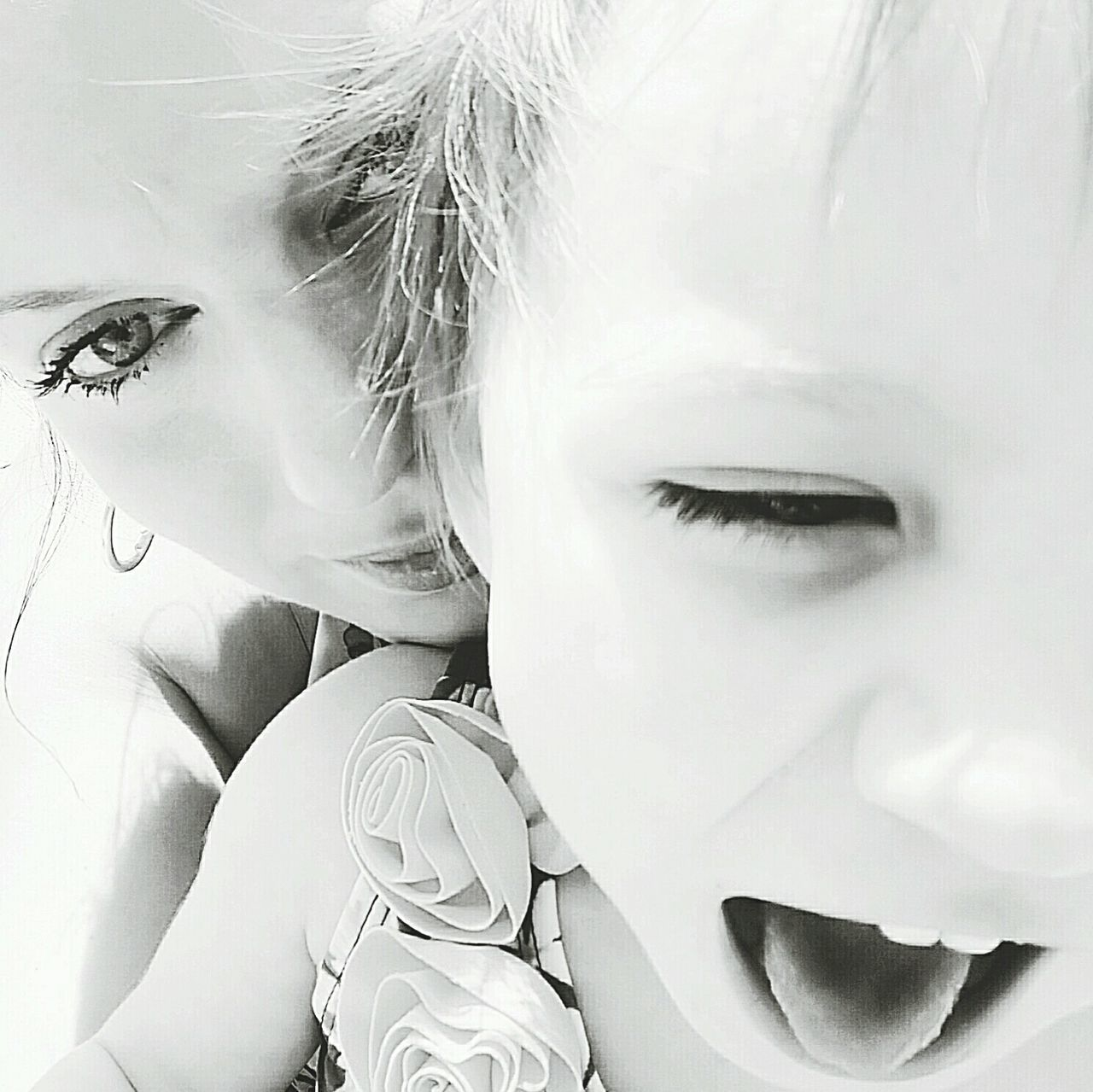 Smile for the camera!!.... Or bite it. Self Portrait My Daughter Black And White Portrait Blackandwhitephotography Showcase: December Mother & Daughter Girl Blackandwhite Photography Funny Funny Faces My Best Photo 2015 RePicturing Motherhood