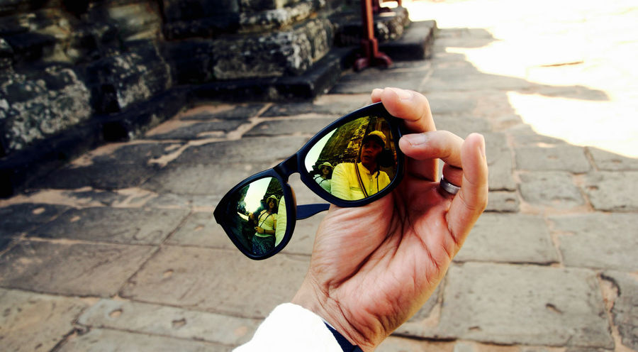 Siam Reap, Cambodia Couple Reflection Close-up Couple - Relationship Day Eyeglasses  High Angle View Holding Human Body Part Human Finger Human Hand Lifestyles Outdoors People Real People Sunglasses Sunlight