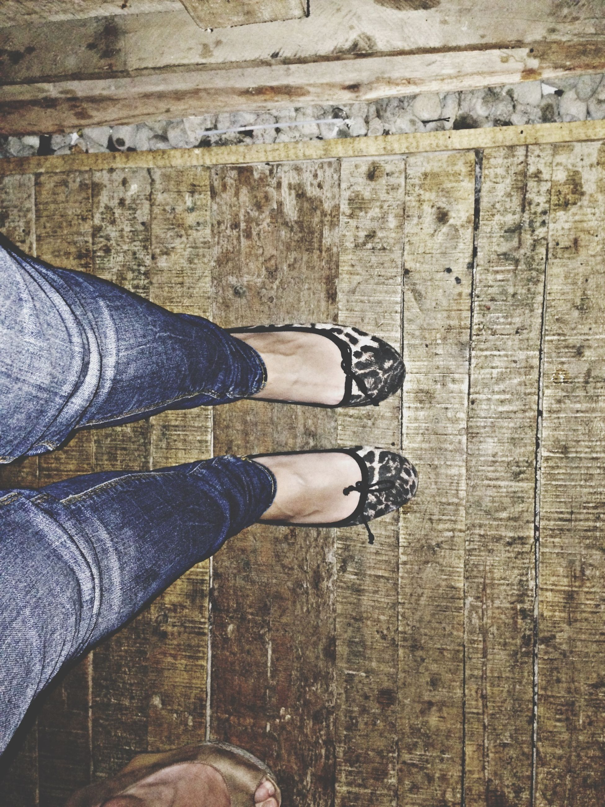 low section, person, shoe, personal perspective, human foot, footwear, lifestyles, standing, jeans, leisure activity, men, high angle view, canvas shoe, part of, unrecognizable person, human limb