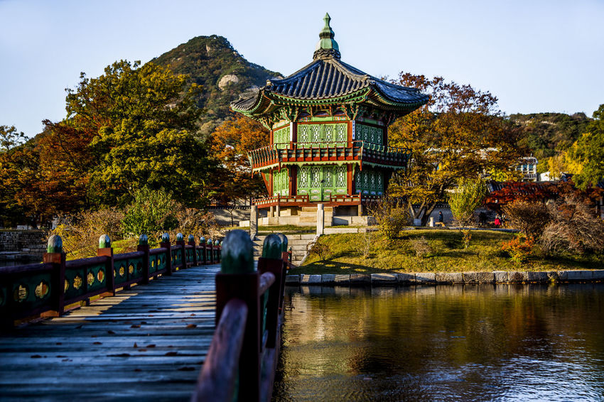 Architecture Building Exterior Built Structure Chosun Dynasty Façade Famous Place Garden Geometry Gyungbok Palace Horizontal Symmetry House Incidental People International Landmark Nautical Vessel Outdoors Reflection Religion Residential Structure River Roof Spirituality Symmetry Travel Water Waterfront