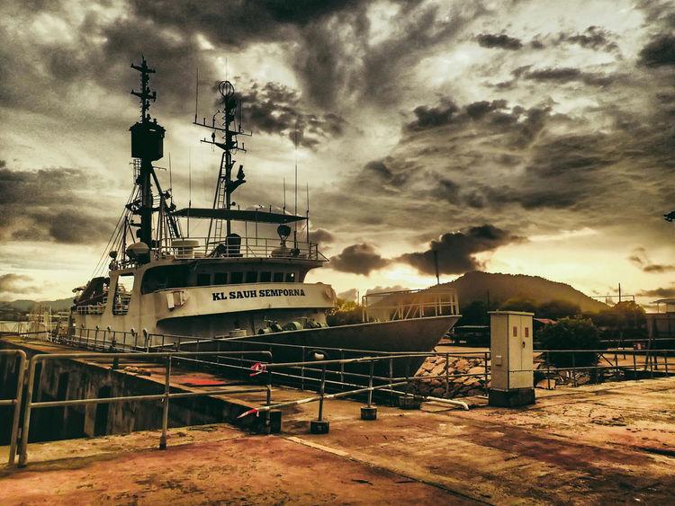 Cloud - Sky Text Sky No People Dramatic Sky Outdoors Day Ship Shipyard Ship Building Ships🚢 Sunset atUniklMIMET Manjung Perak Malaysia Traveling Home For The Holidays Abandoned Ship Rusty Ship Wreck