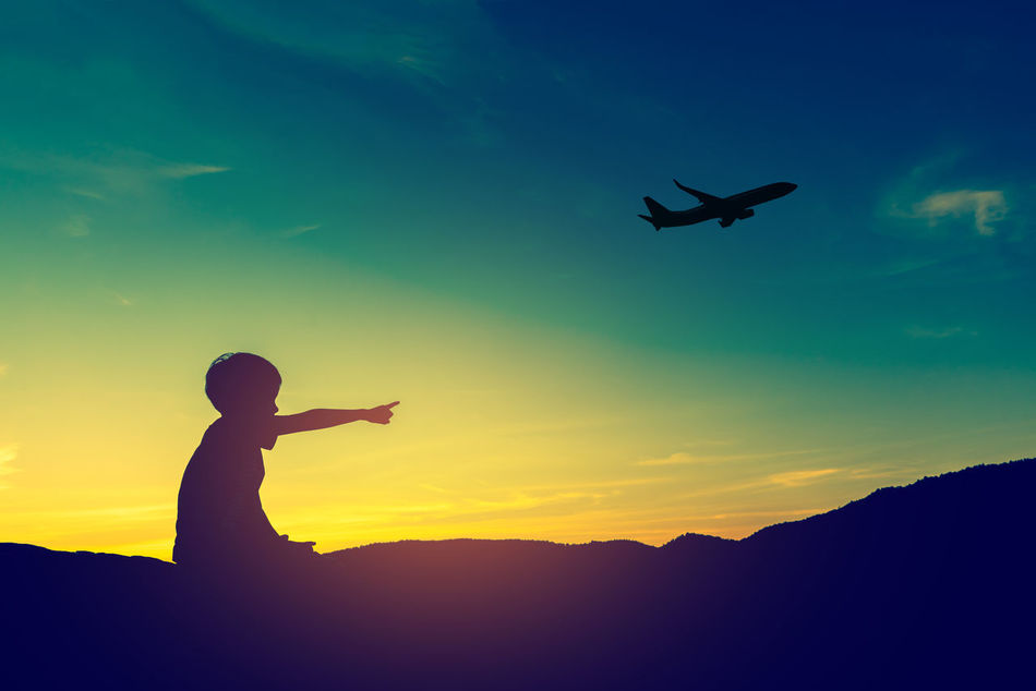 Abstract Beauty In Nature Boy Childhood Day Fly Flying Jet Journey Kid Leisure Activity Lifestyles Nature One Person Outdoors People Plane Real People Shadow Silhouette Sky Sunset Travel