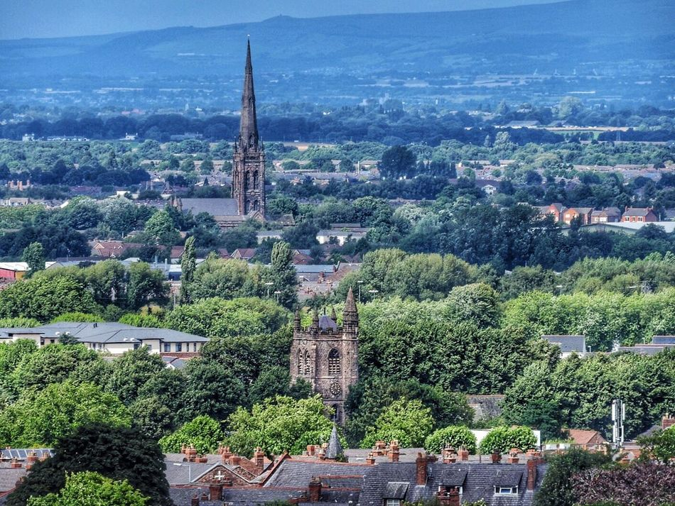 Last one of my home town. The church with the square tower is in the village I grew up in. Churches Trees Distance View Warrington, England Vista Countryside Hazy Sunshine Stockton Heath Church Cheshire Landscape
