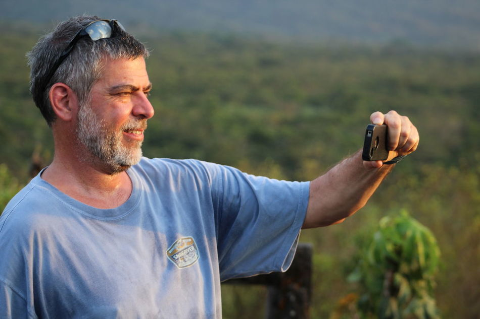 Central America Costa Rica Focus On Foreground Man Taking Photo Outdoors Person Tropical