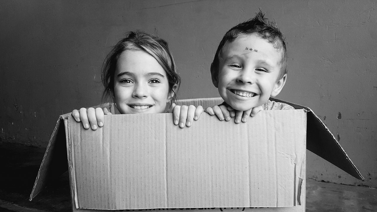 Close-up Children Having Fun :) Boy Girl In A Box Playtime Bonding Time Chidren Photography Black And White Children Playing Cardboard Boxes Youth Expression Young Girl Young Boy Blackandwhite Photography Love To Take Photos ❤
