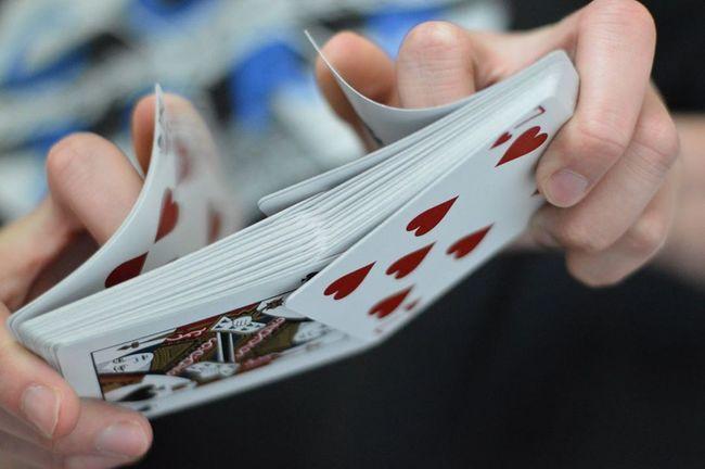 Beautiful Cardistry  Cards Magic Person Redandblack Selective Focus Shuffle Skill