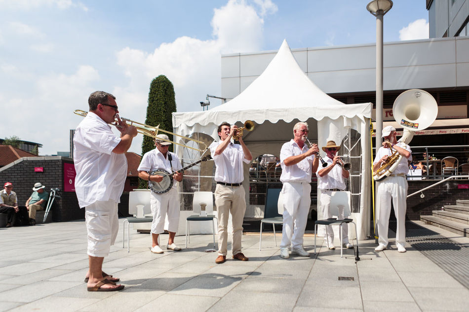 Jazz band playing an open air set at The Mailbox in Birmingham Adults Only Band City Life Clear Blue Sky Concert Dressed In White Full Frame Group Of People Horizontal Jazz Band Mature Adult Men Musicians No Crowd No Edits No Filters No Filter No Other People Paving Stones People Six Summer Unprocessed White Pavillion Wide Angle Wide Angle View