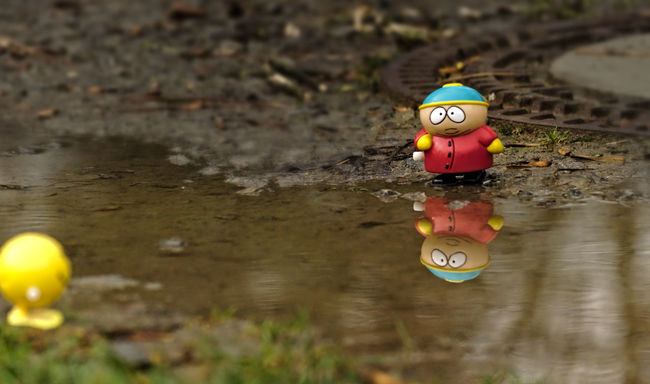 help! Adventure April Showers Arrangement Best Friends Cartman Day Multi Colored Nature Nikon Outdoors Puddle Rainy Day Red Reflection Reflections In The Water Selective Focus Smily Telling Stories Differently Toy Toy Adventures Toy Story Water Reflections Yellow