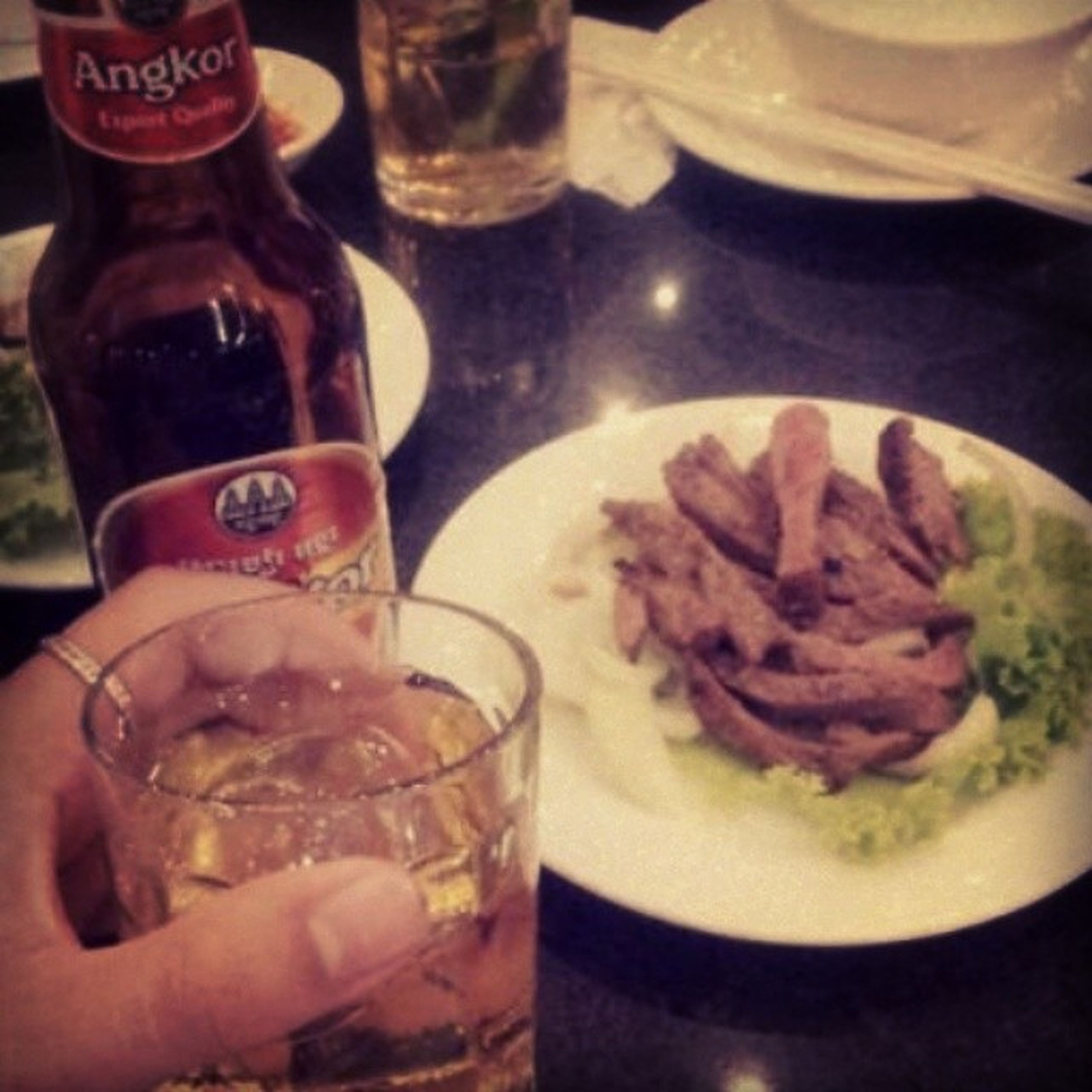 food and drink, food, freshness, indoors, drink, ready-to-eat, refreshment, indulgence, drinking glass, unhealthy eating, table, close-up, person, restaurant, serving size, plate, temptation, part of