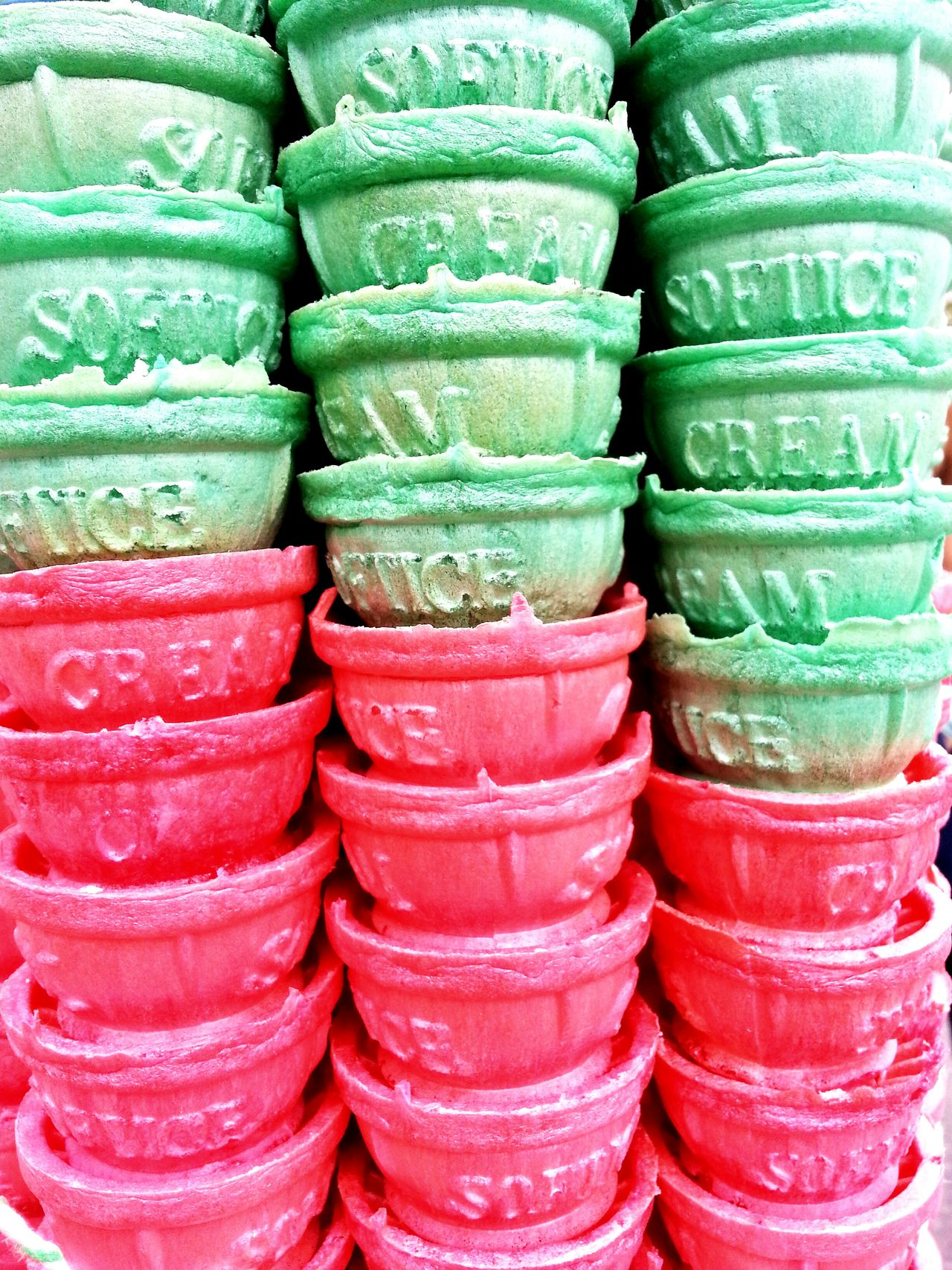 Colors And Patterns pile of cone In A Row Large Group Of Objects Backgrounds Full Frame Stack For Sale Indoors  Still Life Collection Red Choice Arrangement Retail  Variation Multi Colored Green Color Repetition Abundance Order Freshness