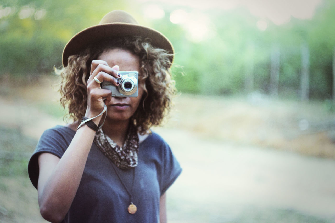 Atmosphere Atmospheric Mood Camera Contemplation EyeEm Best Shots Getting Inspired Happiness Holding Camera Moody Sky Nature One Person Pastel Colors Person Style Taking Photos Woman Wearing Hat Young Woman Young Woman Taking Foto Uniqueness