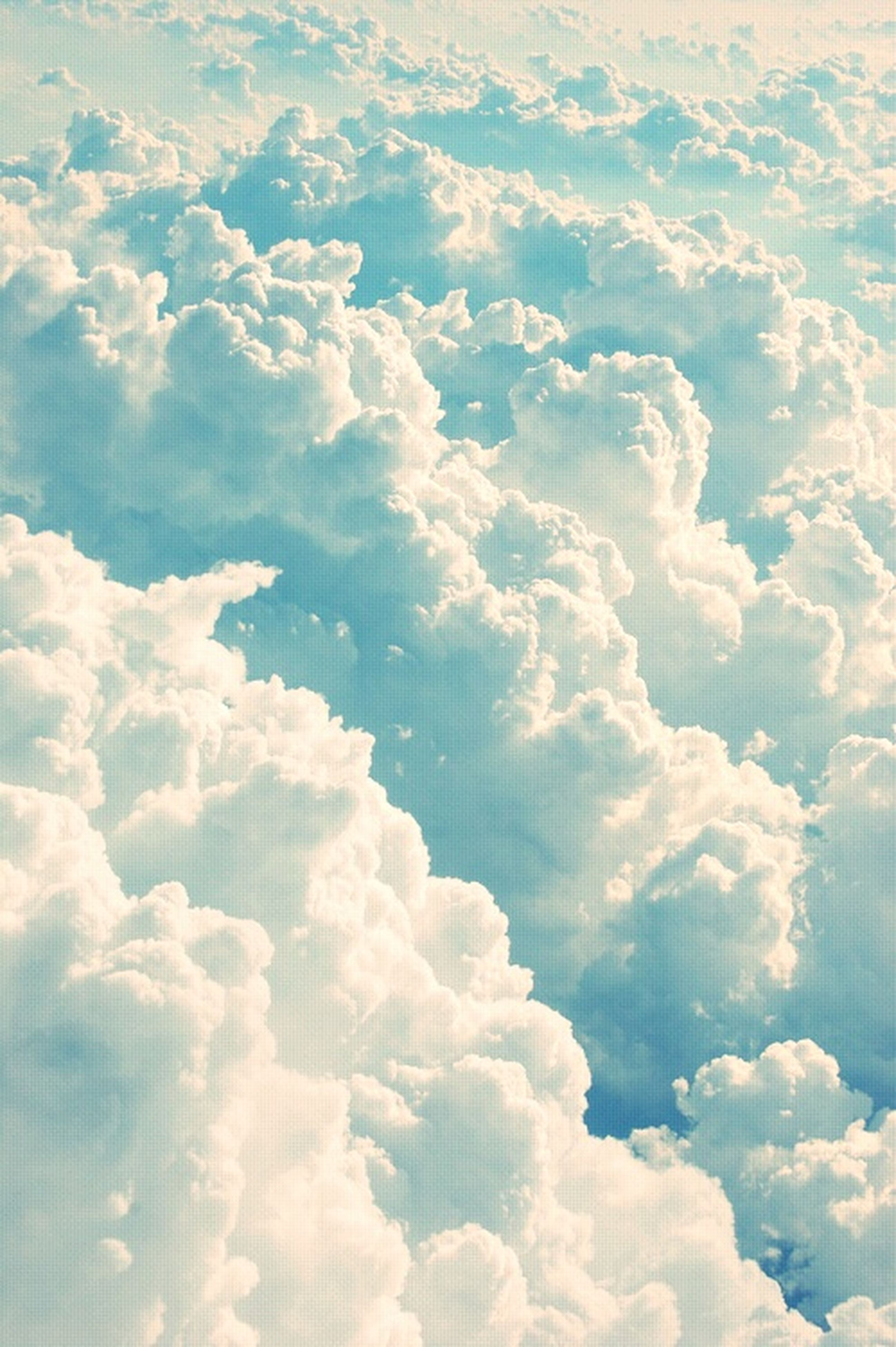 full frame, backgrounds, beauty in nature, sky only, sky, tranquility, cloud - sky, nature, scenics, white color, tranquil scene, cloudscape, cloudy, blue, low angle view, idyllic, no people, weather, day, white