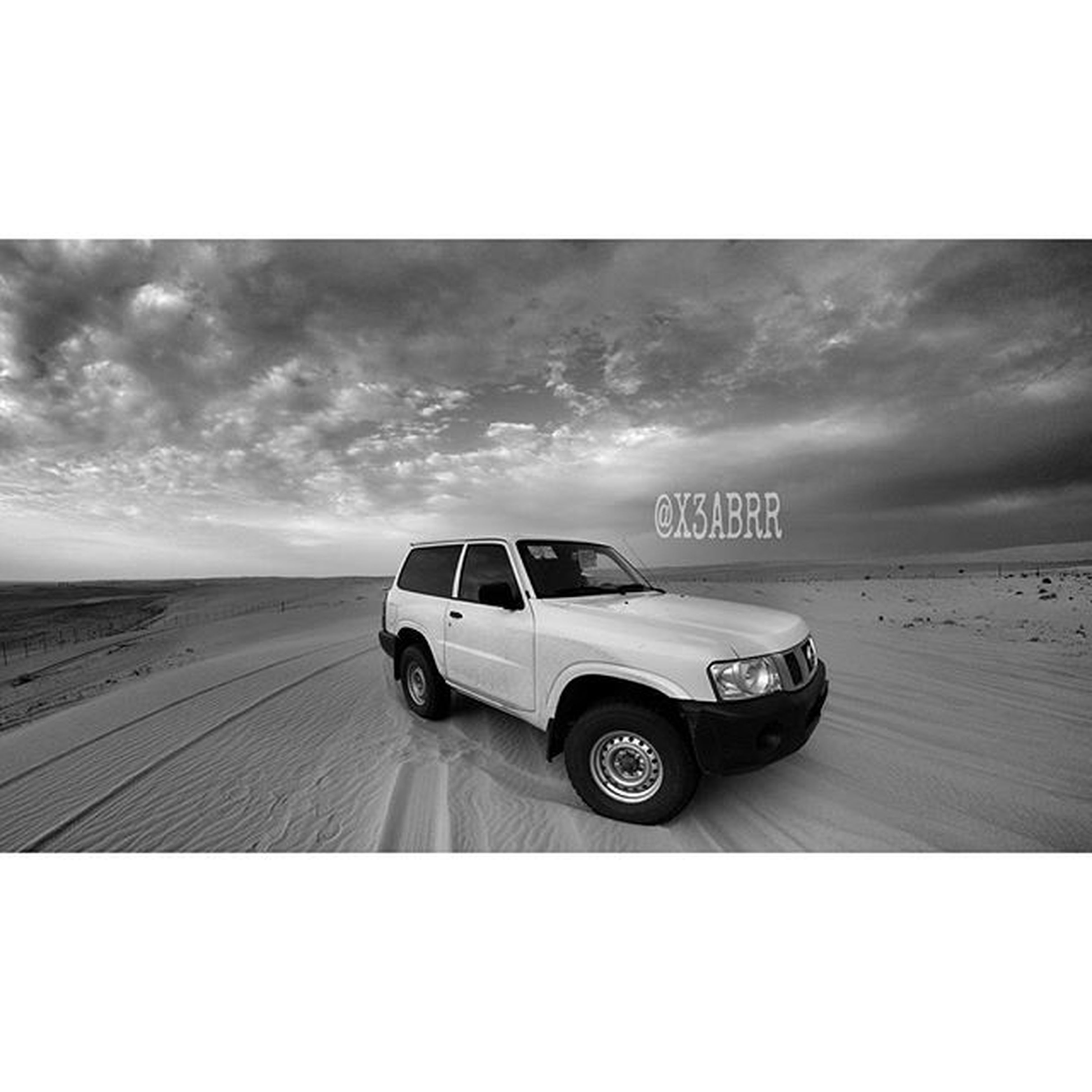 transportation, sky, transfer print, mode of transport, auto post production filter, cloud - sky, land vehicle, car, cloud, cloudy, travel, road, airplane, outdoors, on the move, air vehicle, landscape, day, sand, airport