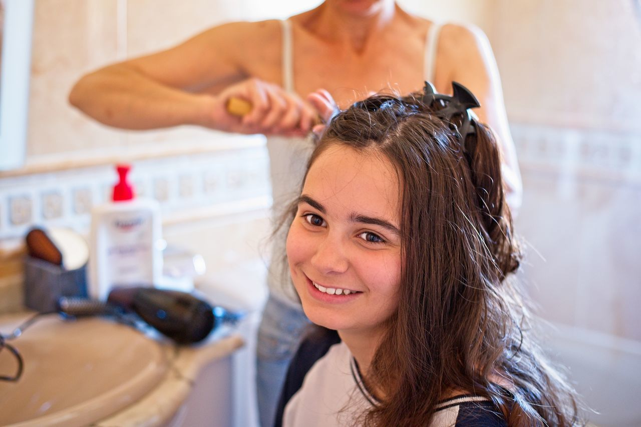 A hairdresser combs a young woman Beauty Treatment Comb Brush Comb Hair Hair Hair Brush Hair Care Hair Dryer Hair Salon Hairdresser Hairdressing Hairdryer Hairstyle Indoors  People Young Adult Young Women
