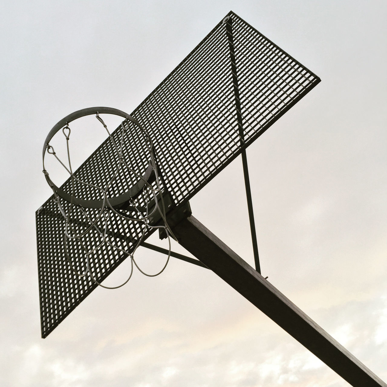 Basket Basketball Basketball Basketball - Sport Basketball Court Basketball Hoop Close-up Court Damaged Day Empty Focus On Foreground Leisure Games Low Angle View Man Made Object Metal Metal Construction Net - Sports Equipment No People Obsolete Outdoors Sky Spool Sport Sports