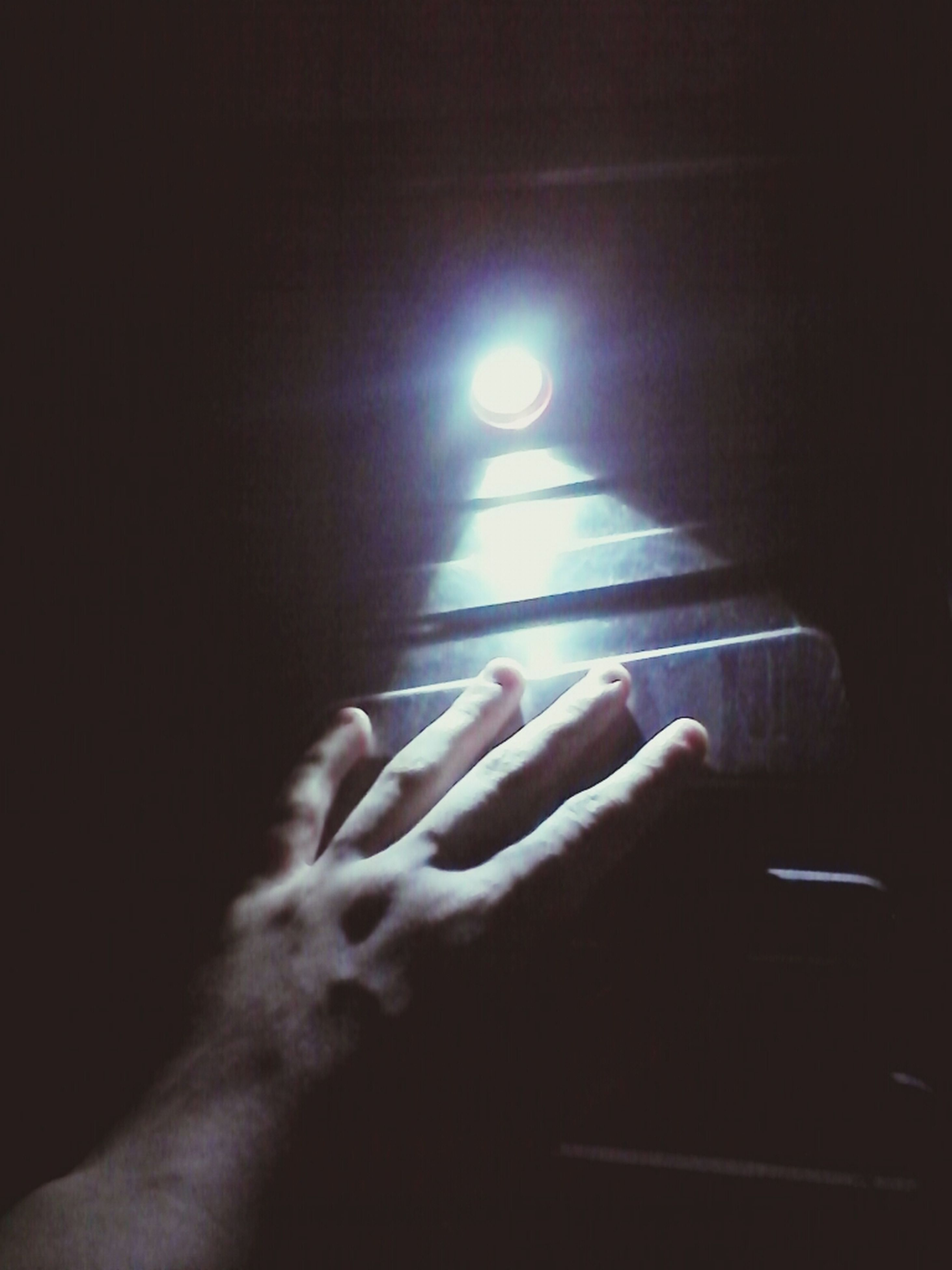 person, part of, human finger, indoors, personal perspective, cropped, unrecognizable person, illuminated, holding, dark, night, close-up, lifestyles, copy space, men, leisure activity, lighting equipment