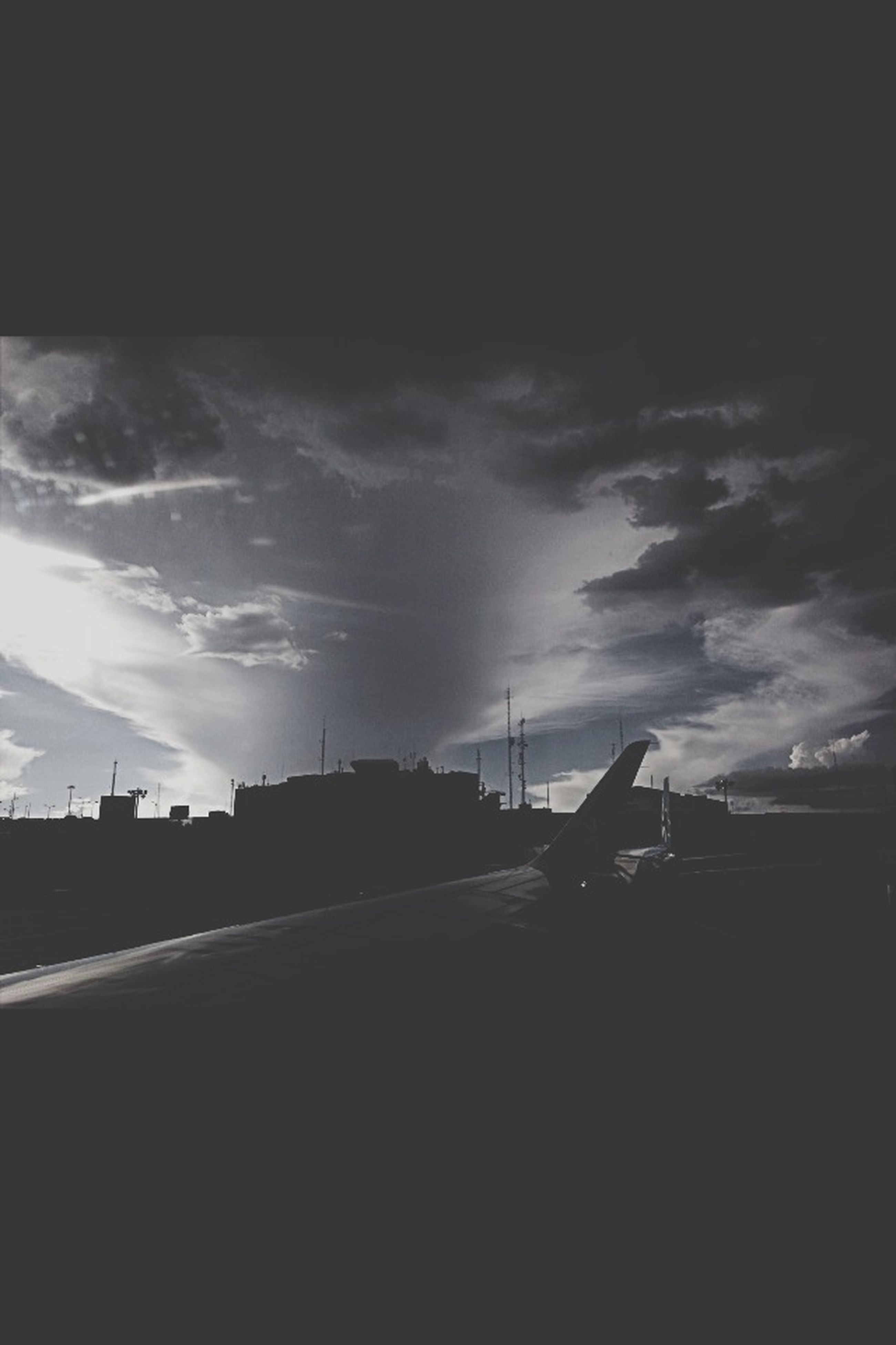 sky, cloud - sky, silhouette, cloudy, transportation, road, cloud, built structure, the way forward, weather, nature, dusk, street, outdoors, sunset, overcast, tranquility, no people, sunlight, architecture