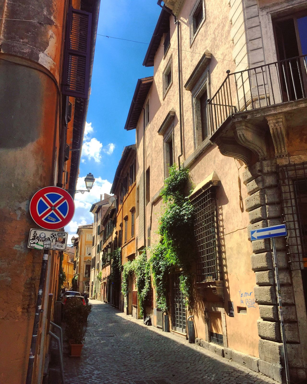 Communication Road Sign Architecture Text Built Structure Building Exterior Guidance Day Speed Limit Sign No People Outdoors Sky Roman Rome Street Wandering Italy Window Garden Balcony