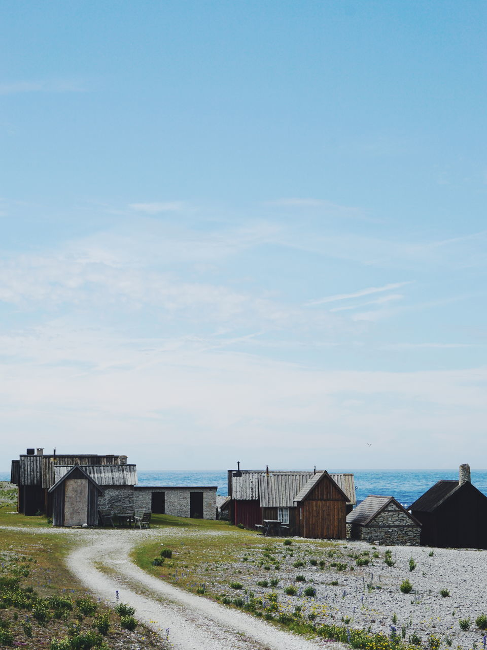 Old Fishing Village On Shore At Beach Against Sky At Helgumannen