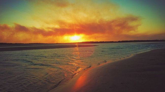Golden sunset at Elliott Heads Beach with smoke on horizon displaying beautiful colours on the water and sand Atmospheric Mood Beach Beauty In Nature Bundaberg Beaches Colourful Landscape Dusk Golden Sunset Nature No People Outdoors Sand Sea Sky Sunset Tide Tranquil Scene Tranquility Water Waves