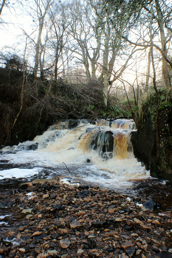 Waterfalls over pebbles