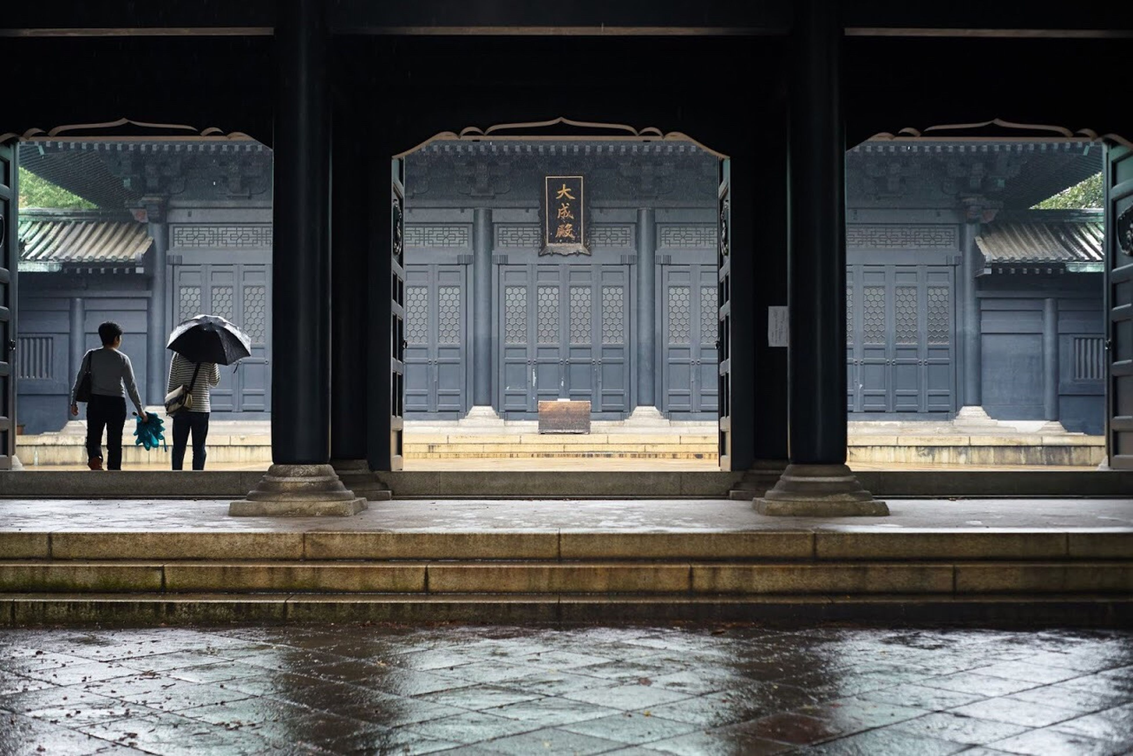Indoors  Architecture Built Structure Religion Place Of Worship Rear View Spirituality Arch Person Day Arched Tourism Famous Place Façade Rainy Days Outdoors Gate Yushimaseido EyeEm Best Shots EyeEm Gallery Architecture