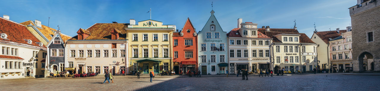 Panoramic view of the architecture with colorful medieval houses on the City Hall square in the Historical Centre of Tallinn. UNESCO World Heritage site. Estonia Architecture Building Exterior Built Structure City Day Est Façade Heritage Building Landmark Medieval Outdoors Panoramic Panoramic Photography Sky Tallinn Tallinn Old Town Travel Destinations