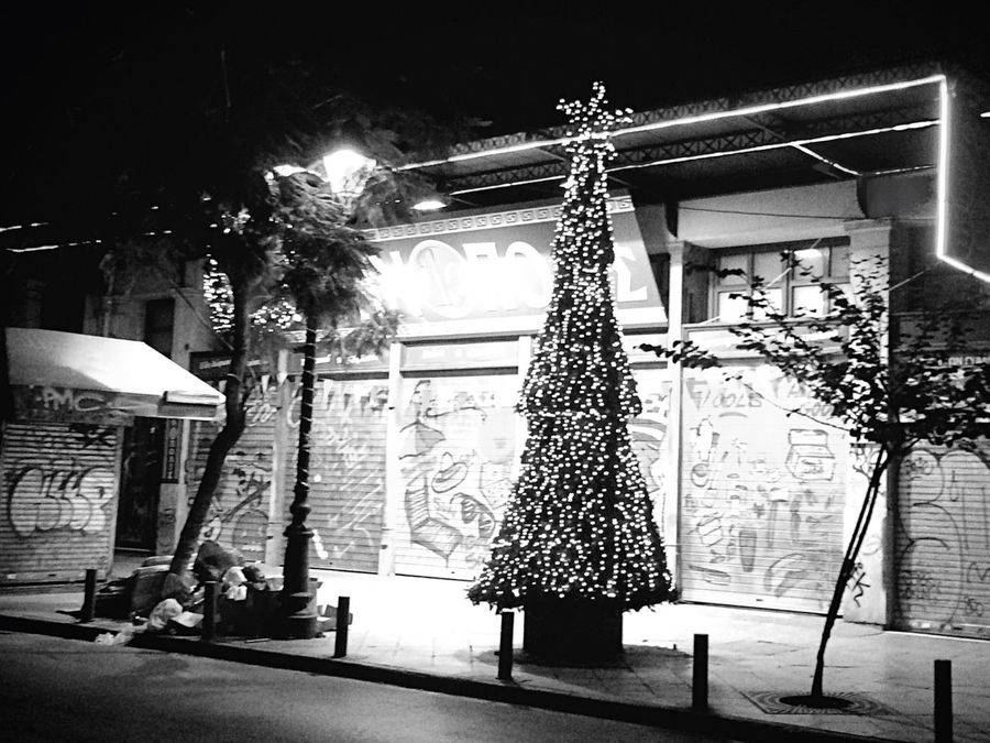 Just another Christmas Tree 🌲with Christmas Lights ✨and the usual Christmas Decorations 🎈near a Garbage Spot and at the Background Graffiti Art set there by the End of October Advent for Bwn_friday_eyeemchallenge No People Blackandwhite Playing With Shadows City Center Athens Bnw_friday_eyeemchallenge