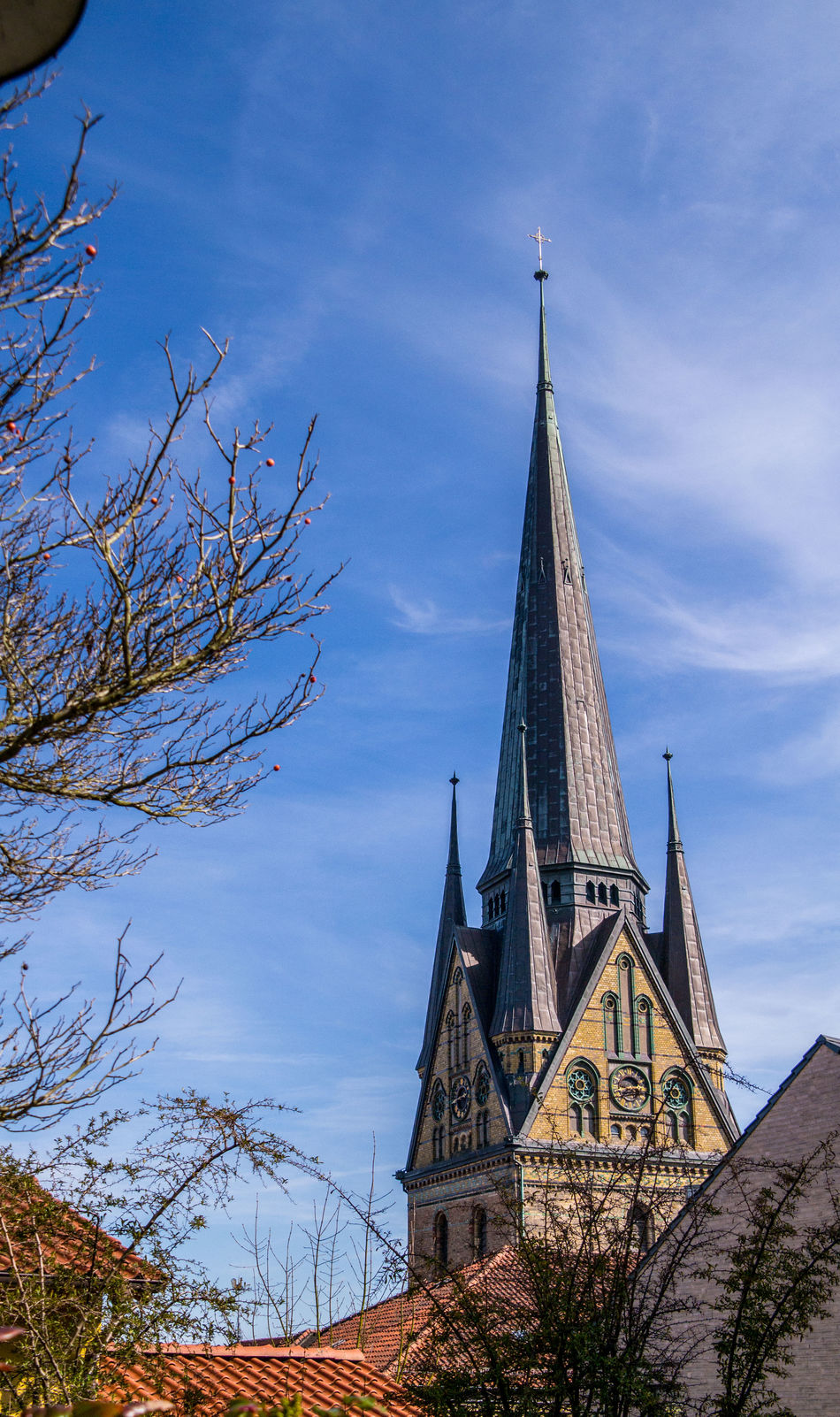 church tower of the Flensburg St Nikolai church from distance Architecture Built Structure Church Church Tower Church Towers Cultures Day Flensburg No People Outdoors Place Of Worship Religion Sky Spirituality St Nikolai Sunny Tower Tree