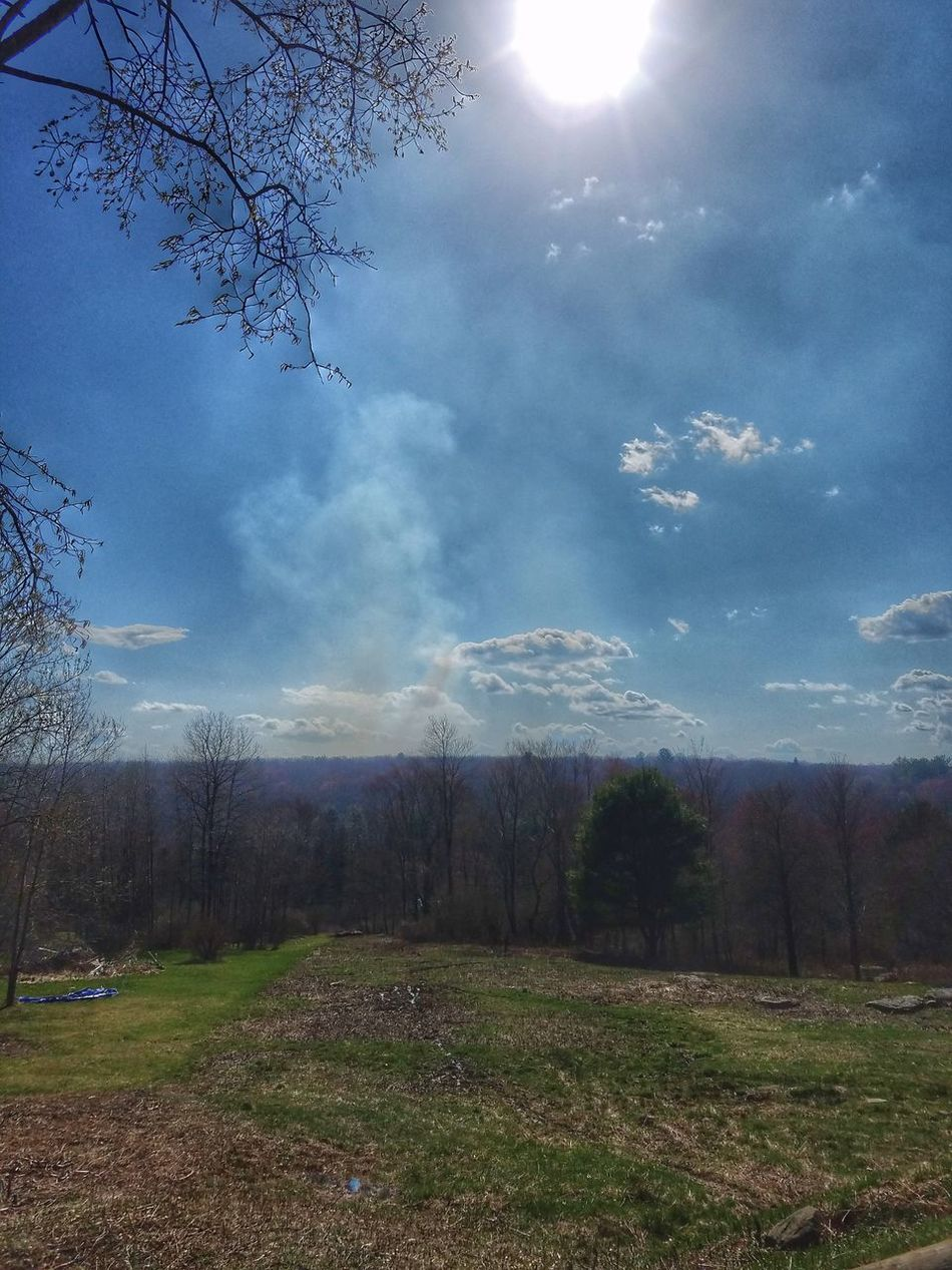 Smoke mixing with the clouds on this beautiful Easter Sunday causing much concern because it's so blustery today. Thinking of my in-laws/neighbors who are fighting this brush fire. Smoke Brush Fire Grass No People Outdoors Nature Landscape Sky Beauty In Nature Day Tree Freshness Astronomy