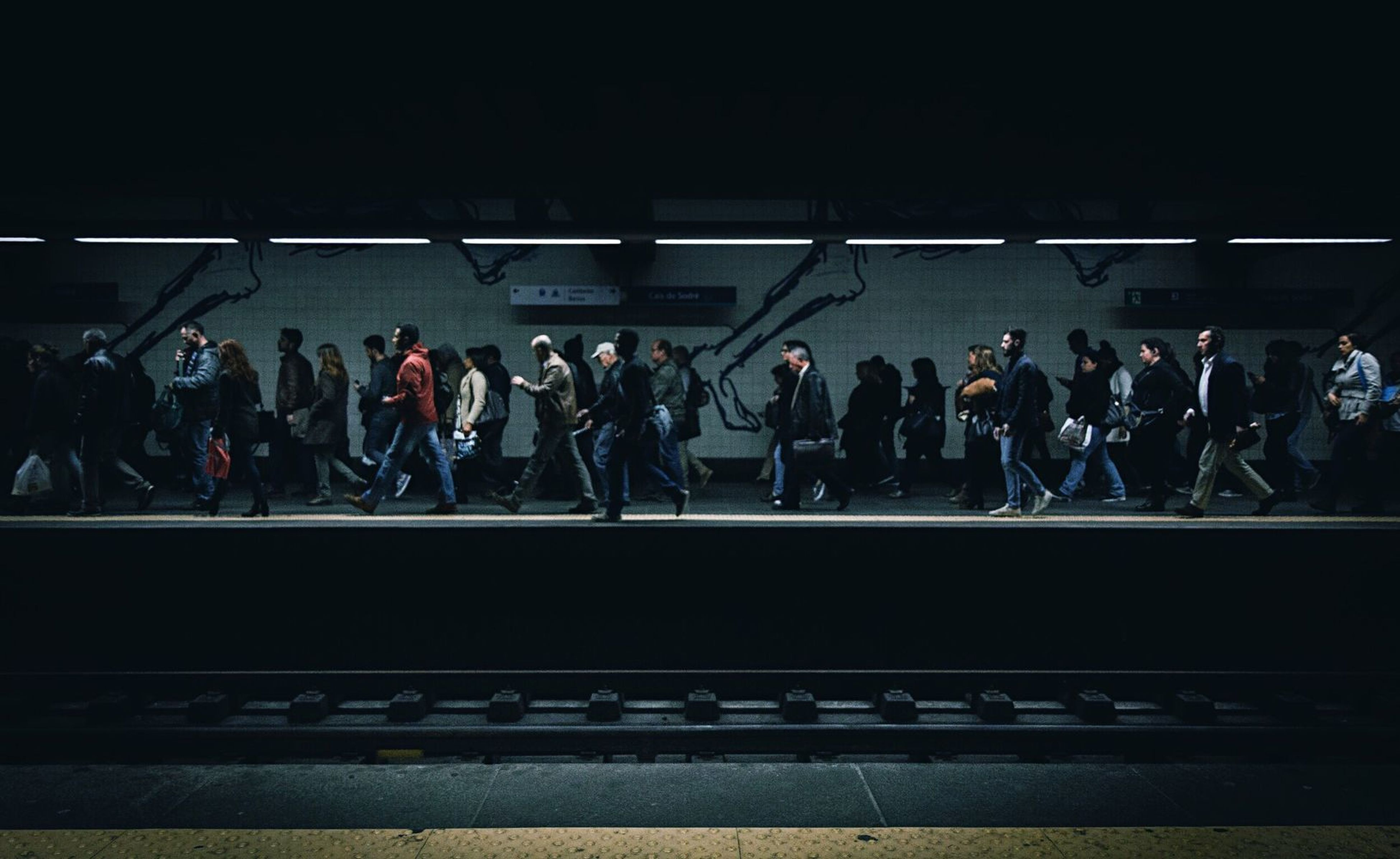 large group of people, full length, men, waiting, indoors, young adult, people, adults only, women, commuter, adult, crowd, togetherness, only men, day