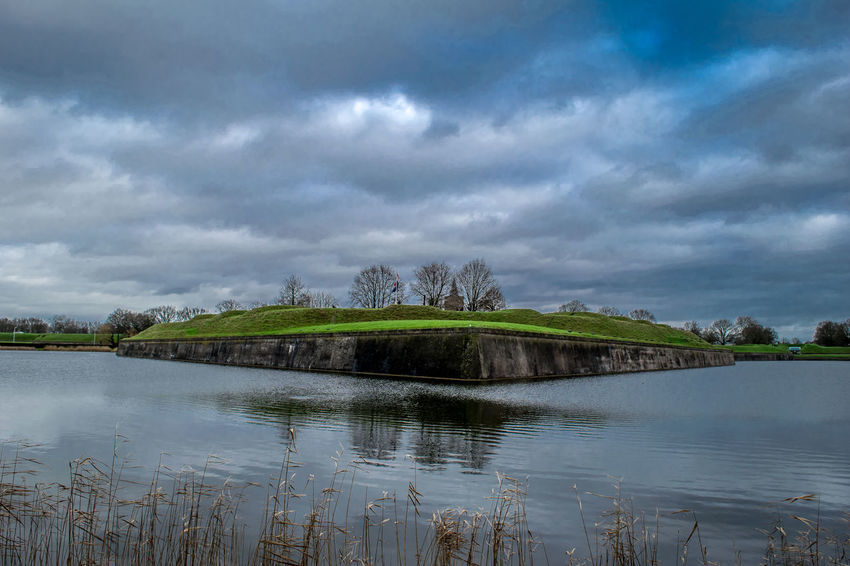Naarden Architecture Beauty In Nature Bestoftheday Check This Out Cloud Cloud - Sky Cloudy Day Dramatic Sky Idyllic Lake Nature No People Non-urban Scene Outdoors Overcast Reflection Rippled Scenics Sky The Great Outdoors - 2016 EyeEm Awards Tranquil Scene Tranquility Water Weather