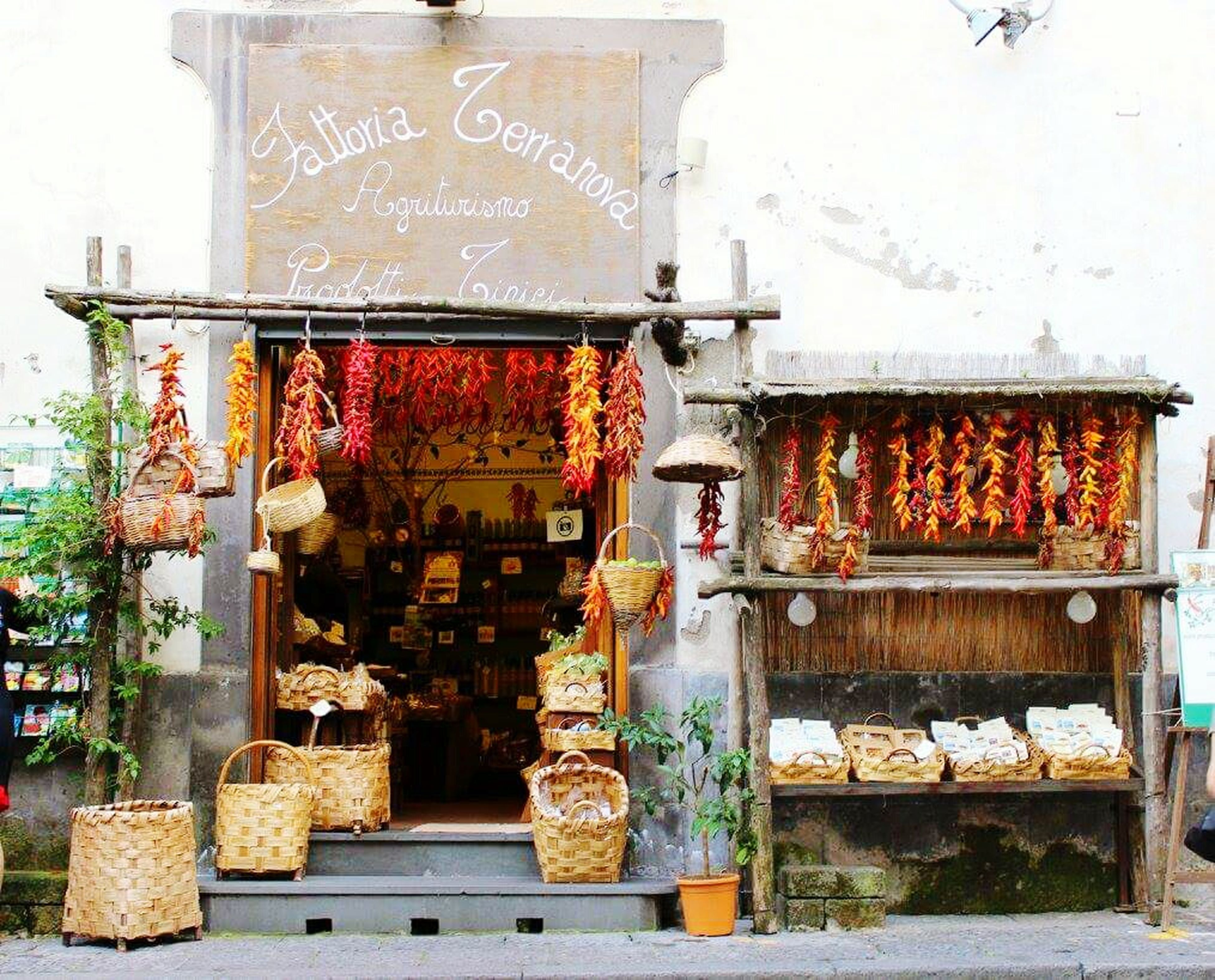 retail, for sale, building exterior, food, market, text, food and drink, market stall, architecture, built structure, store, variation, western script, abundance, display, outdoors, wall - building feature, day, large group of objects, healthy eating